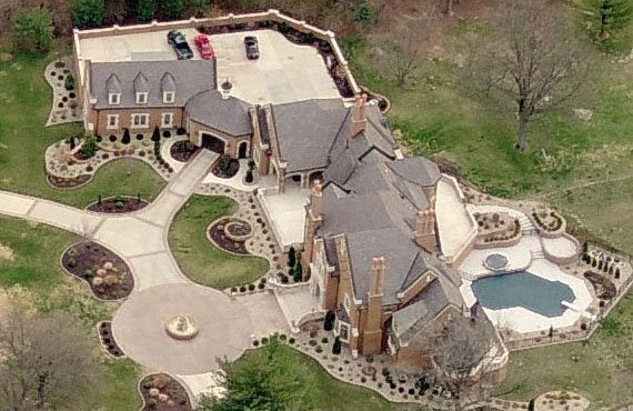 A look at two missouri tudor style mansions homes of the for Mansion house plans with indoor pool